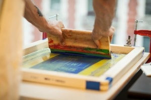 man doing custom screen printing